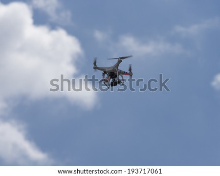 New York, NY USA - May 17, 2014: Phantom drone flying above 8th annual dance parade on Broadway - stock photo
