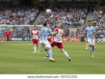 New York, NY USA - May 21, 2016: RJ Allen (27) of NYC FC & Mike Grella (13) of Red Bulls fight for ball at MLS game NYC FC against Red Bulls at Yankee stadium. Red Bulls won 7-0 - stock photo