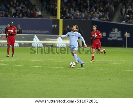 New York, NY USA - November 6, 2016: Andrea Pirlo (21) of NYC FC controls ball during MLS Cup Eastern Conference semifinal against Toronto FC at Yankee stadium Toronto won 5 - 0