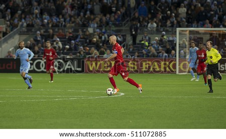 New York, NY USA - November 6, 2016: Michael Bradley (4) of Toronto FC controls ball during MLS Cup Eastern Conference semifinal against NYC FC at Yankee stadium Toronto won 5 - 0