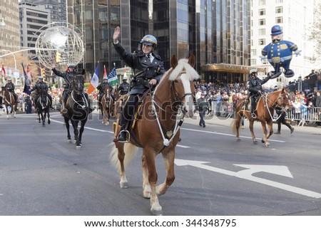 New York, NY USA - November 26, 2015: NYPD Mounted unit at the 89th Annual Macy's Thanksgiving Day Parade on Columbus Circle - stock photo
