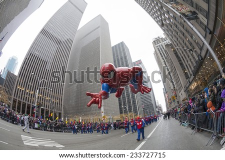 New York, NY USA - November 27, 2014: Spider-man by Marvel balloon is flown at the 88th Annual Macy's Thanksgiving Day Parade along 6th avenue - stock photo