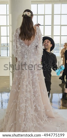 New York, NY, USA - October 5, 2016: A model shows out a dress by Georgina Chapman and Keren Craig for Marchesa Fall/Winter 2017 Bridal Presentation during NYIBW at Canoe Studio, Manhattan