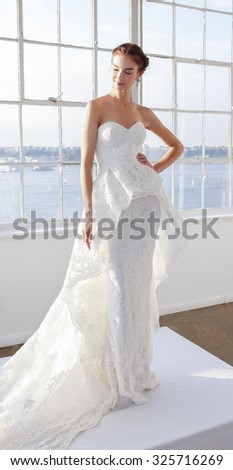 New York, NY, USA - October 8, 2015: A model shows out a dress by Marchesa for Marchesa Fall/Winter 2016 Bridal Presentation at Canoe Studio, Manhattan - stock photo