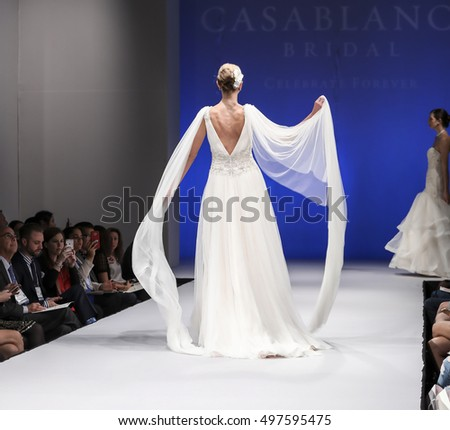 New York, NY, USA - October 8, 2016: A model walks runway for Casablanca Bridal Spring 2017 Collection during New York International Bridal Week at the Fashion Theater, Pier 94, Manhattan