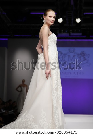 New York, NY, USA - October 11, 2015: A model walks runway for Privato by Mon Cheri 2016 Bridal Collection during New York International Bridal Week at the Fashion Theater, Pier 94, Manhattan