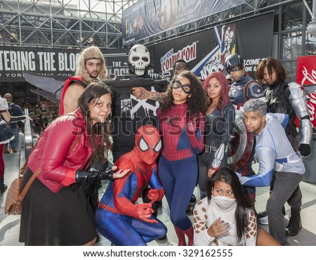 New York, NY, USA - October 9, 2015: Comic Con attendees pose in the costumes during Comic Con 2015 at The Jacob K. Javits Convention Center in New York City.   - stock photo