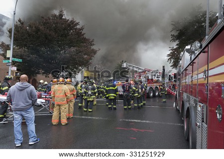New York, NY USA - October 25, 2015: Firefighters battle fire on Bedford Park Boulevard in the Bronx - stock photo