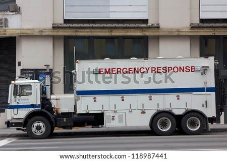NEW YORK, NY, USA - OCTOBER 31: NYPD police emergency response vehicle parked in the streets of Lower Manhattan in the aftermath of hurricane Sandy in New York, NY, USA, on October 31, 2012. - stock photo
