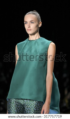 New York, NY, USA - September 12, 2015: A model walks the runway at Monique Lhullier runway show during of Spring 2016 New York Fashion Week at The Arc, Skylight at Moynihan Station, #CFDANYFW, #NYFW, - stock photo