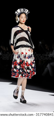 New York, NY, USA - September 10, 2015: A model walks the runway at the Desigual runway show during of Spring 2016 New York Fashion Week at The Arc, Skylight at Moynihan Station, #Desigual, #NYFW, - stock photo