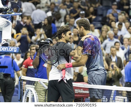 New York, NY USA - September 6, 2017: Juan Martin del Potro of Argentina embraces Roger Federer of Switzerland at US Open Championships at Billie Jean King National Tennis Center