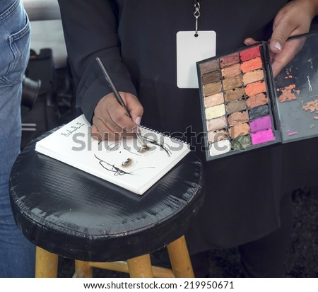 New York, NY, USA - September 04, 2014: Makeup artist on backstage  for Desigual Spring 2015 Runway show during Mercedes-Benz Fashion Week New York at the Theatre at Lincoln Center, Manhattan - stock photo
