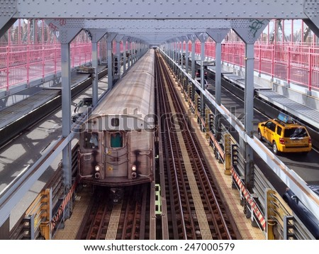 NEW YORK, NY, USA - SEPTEMBER 14, 2013: Subway train and yellow cab pass each other on the Williamsburg Bridge in New York, NY, USA on September 14, 2013. - stock photo