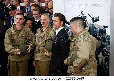 """NEW YORK-OCT 15: Actor Brad Pitt poses with soldiers at the world premiere of """"The Fury"""" at the Newseum on October 15, 2014 in Washington DC. - stock photo"""