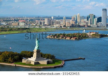 NEW YORK - OCT 15: Aerial view of the Statue of Liberty and Ellis Island on Oct 15 2010. From 1892 to 1954, over 12 million immigrants entered USA through the portal of Ellis Island in New York Harbor - stock photo