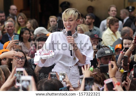 NEW YORK - OCT 7: Miley Cyrus performs on NBC's Today Show at Rockefeller Plaza on October 7, 2013 in New York City.