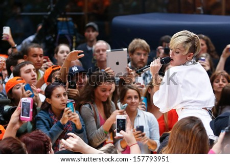 NEW YORK-OCT 7: Recording artist Miley Cyrus performs on NBC's 'Today Show' at Rockefeller Plaza on October 7, 2013 in New York City. - stock photo
