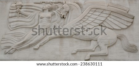 NEW YORK OCT 24: Rockefeller Center woman holding a torch in her right hand and an electrical bolt  in her left hand. She is soaring with the mythological winged horse Pegasus on Oct 24, 2013 in NY - stock photo