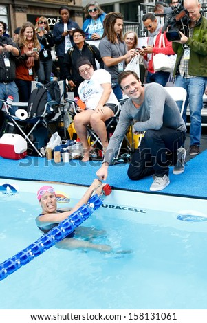 NEW YORK- OCT 8: Swimmer Diana Nyad and Olympic gold medalist Ryan Lochte attend Day 1 of 'Swim For Relief' benefiting Hurricane Sandy Recovery at Herald Square on October 8, 2013 in New York City.  - stock photo