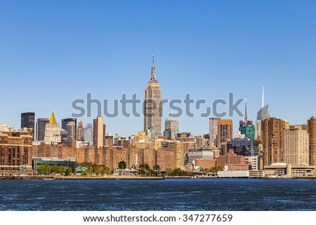 NEW YORK - OCT 23, 2015: The Empire State Building shines in the afternoon in New York, USA. The Empire State Building is a 102-story landmark and American cultural icon in New York. - stock photo