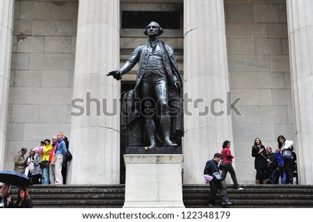 NEW YORK - OCT 09: Visitors under the Statue of George Washington at the Federal Hall on October 09 2009 in Wall Street Manhattan New York.It was built in 1842 as the United States Custom House - stock photo