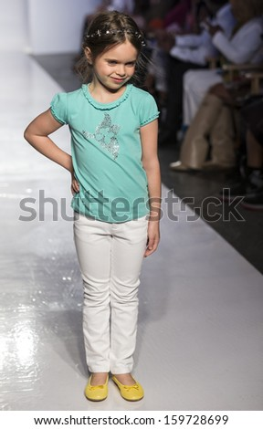NEW YORK - OCTOBER 5: A model walks at Tartine et Chocolat preview during the Swarovski at petitePARADE NY Kids Fashion Week in Collaboration with Vogue Bambini on  OCTOBER 5, 2013 in New York - stock photo