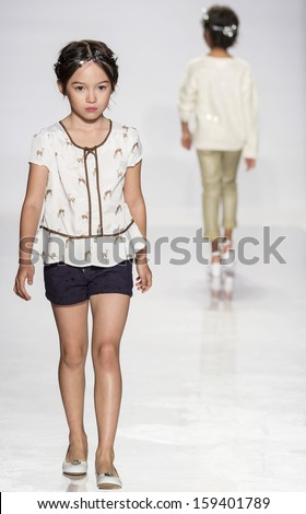 NEW YORK - OCTOBER 5: A model walks the runway at Nina preview during the Swarovski at petitePARADE NY Kids Fashion Week in Collaboration with Vogue Bambini on  OCTOBER 5, 2013 in New York - stock photo