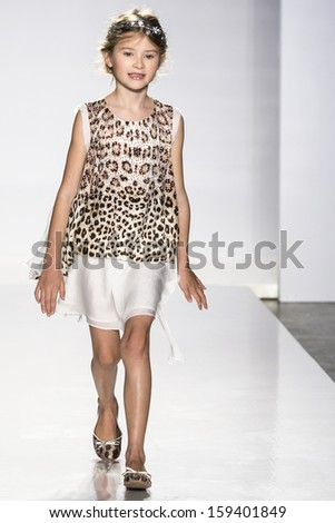 NEW YORK - OCTOBER 5: A model walks the runway at Roberto Cavalli Junior preview during the Swarovski at petitePARADE NY Kids Fashion Week on  OCTOBER 5, 2013 in New York - stock photo
