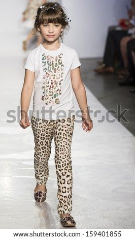 NEW YORK - OCTOBER 5: A model walks the runway at Roberto Cavalli Juniorpreview during the Swarovski at petitePARADE NY Kids Fashion Week on  OCTOBER 5, 2013 in New York - stock photo