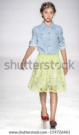 NEW YORK - OCTOBER 5: A model walks the runway at Ruum preview during the Swarovski at petitePARADE NY Kids Fashion Week in Collaboration with Vogue Bambini on  OCTOBER 5, 2013 in New York - stock photo