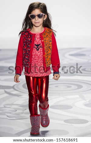 NEW YORK - OCTOBER 5: A model walks the runway at the Truly Scrumptious designed by Heidi Klum at Vogue Bambini - Petite Parade Kids Fashion Week on OCTOBER 5, 2013 in New York - stock photo