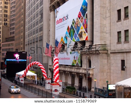 NEW YORK, OCTOBER 17: A Shutterstock banner hangs on the front of the New York Stock Exchange building in New York City, October 17, 2012. Shutterstock listed on the NYSE October 11, 2012. - stock photo