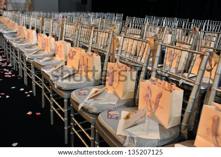 NEW YORK- OCTOBER 14: Gift bags on seats before runway for Claire Pettibone bridal show for Fall 2013 during NY Bridal Fashion Week on October 14, 2012 in New York City, NY - stock photo