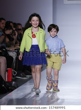 NEW YORK - OCTOBER 5: Girl and boy walk runway for Ugg Australia ...