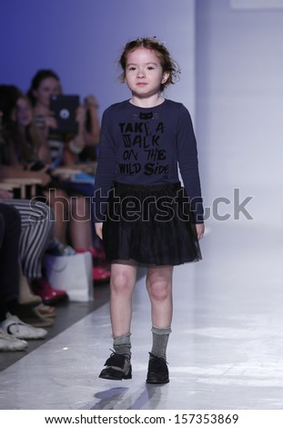NEW YORK - OCTOBER 5: Girl walks runway for IKKS Junior ready-to-wear Swarovski collection at Vogue Bambini petiteParade Kids Fashion Week at Industrial Superstudio on October 5, 2013 in NYC