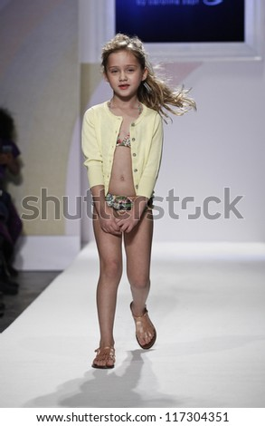 NEW YORK - OCTOBER 21: Girl walks runway for petite Parade show by Baby CZ during kids fashion week sponsored by Vogue Bambini & Swarovski Elements at Industria Superstudio on October 21, 2012 in NYC