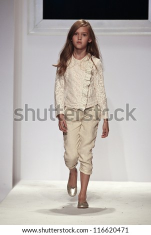 NEW YORK - OCTOBER 21: Girl walks runway for petite Parade show by Ki6? (chi sei?) during kids fashion week sponsored by Vogue Bambini at Industria Supertudio on October 21, 2012 in New York City