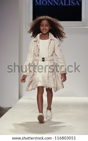NEW YORK - OCTOBER 21: Girl walks runway for petite Parade show by Monnalisa during kids fashion week sponsored by Vogue Bambini at Industria Superstudio on October 21, 2012 in New York City