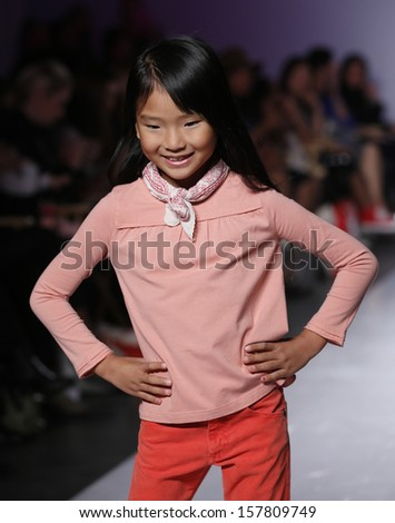 NEW YORK - OCTOBER 6: Girl walks runway for Stride Rite Children's Group by Nordstrom Stride Rite at Vogue Bambini petiteParade Kids Fashion Week at Industrial Superstudio on October 6, 2013 in NYC