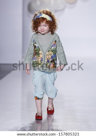 NEW YORK - OCTOBER 6: Girl walks runway for SUOAK by Elly Geana-Park at Vogue Bambini petiteParade Kids Fashion Week at Industrial Superstudio on October 6, 2013 in New York City