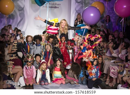 NEW YORK - OCTOBER 5: Heidi Klum and models pose at the Truly Scrumptious designed by Heidi Klum at Vogue Bambini - Petite Parade Kids Fashion Week on OCTOBER 5, 2013 in New York