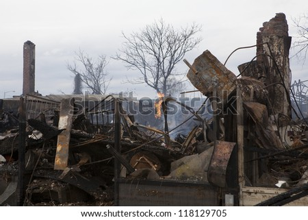 NEW YORK - October 31: Homes sit smoldering after Hurricane Sandy on October 30; 2012 in the Far Rockaway area  on October 30; 2012 in New York City; NY - stock photo