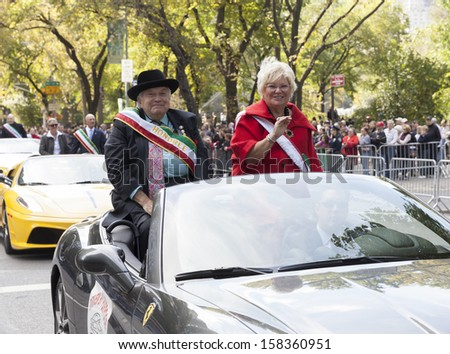 NEW YORK - OCTOBER 14: Honoree Joseph Mattone (L) attends the annual Columbus Day Parade on 5th Avenue on October 14, 2013 in New York City
