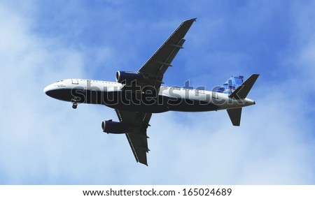 NEW YORK - OCTOBER 17:JetBlue Airbus A320 in New York sky before landing at JFK Airport on October 17, 2013. JetBlue Airways is an American low-cost airline with main base at JFK International Airport - stock photo