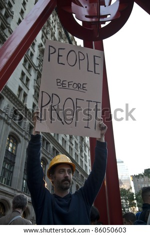 NEW YORK - OCTOBER 05: Kevin Gunderson of New York holds sign at the rally with 'Occupy Wall Street' in Downtown Manhattan on October 05, 2011 in New York. - stock photo