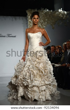 NEW YORK - OCTOBER 17: Model walking runway at the Prina Tornai Bridal Collection for Spring/ Summer 2012 during NY Bridal Fashion Week on October 17, 2011 in New York, USA
