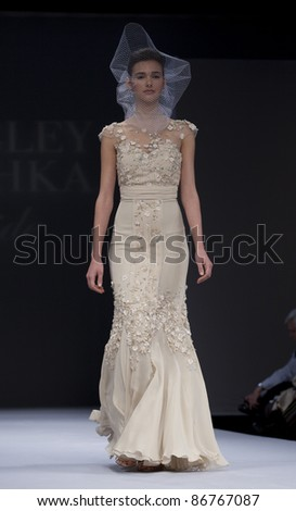 NEW YORK - OCTOBER 16: Model walks runway for Badgley Mischka bridal collection by Mark Badgley & James Mischka at New York International Bridal Week at 94 Pier on October 16, 2011 in New York City - stock photo