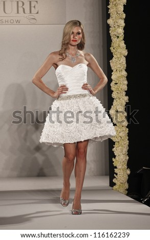 NEW YORK - OCTOBER 13: Model walks runway for Couture show collection by Melanie Harris during New York Bridal fashion week at Hilton New York on October 13, 2012 in New York City - stock photo
