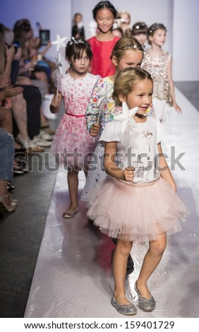 NEW YORK - OCTOBER 5: Models walk during the Swarovski finale at petitePARADE NY Kids Fashion Week in Collaboration with Vogue Bambini on  OCTOBER 5, 2013 in New York - stock photo